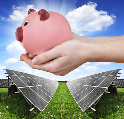 piggy bank held over solar panels array